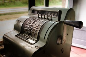 An antique cash register in need of replacing